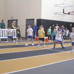 Runners waiting for start of 50 m at CYO indoor track meet